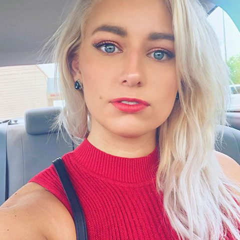 Alexandria Knight with blue eyes and red lips stick