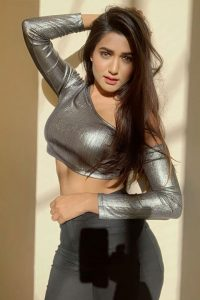 Garima Chaurasia is wearing grey blouse and showing her bold curvy personality.