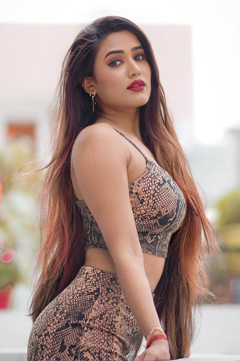 Garima Chaurasia is looking stunning in red lipstick and open hair.