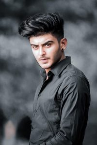 Ibrahim Butt wearing black shirt and is looking dashing with his subtle and serious look
