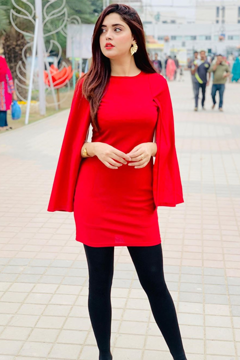 Kanwal Aftab in dark red dress complementing her healthy curvy physique