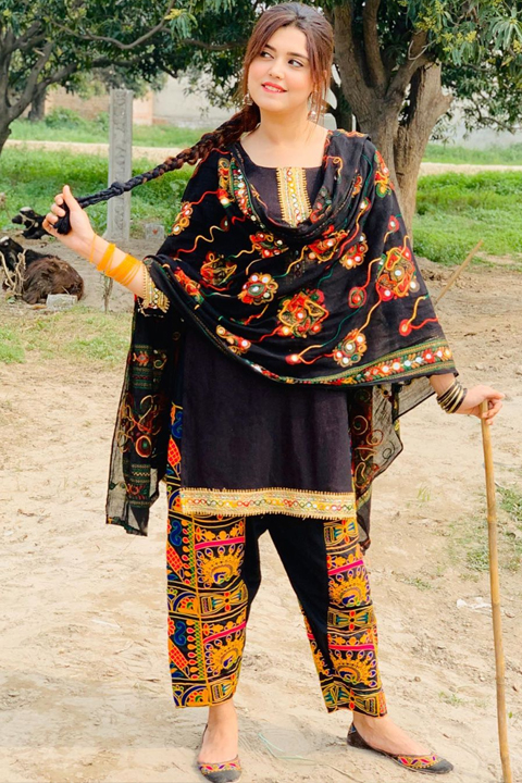 Kanwal Aftab playing with long stick while biting her lips