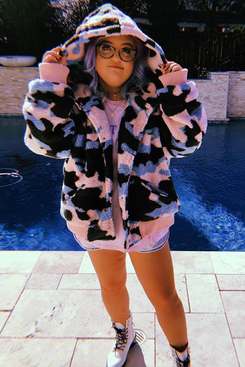 Lauren Godwin in amazing hoodie at the edge of swimming pool