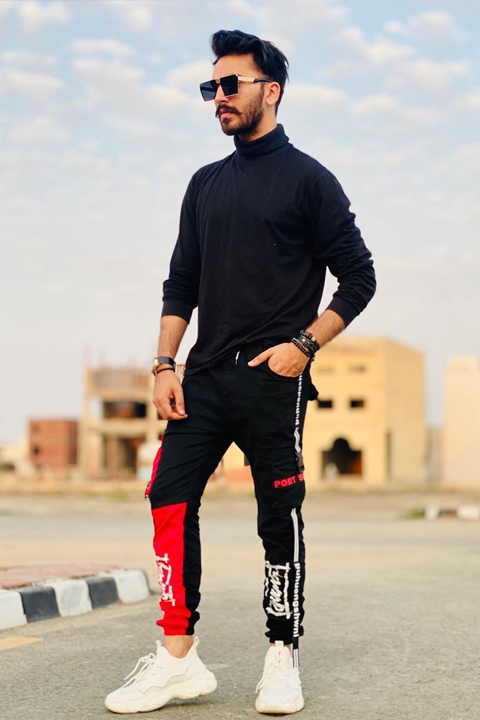 Mj Ahsan wearing all black and posing