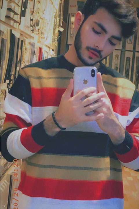 Mubeen Rehman wearing 3 color full sleeves shirt with white Iphone xmax in hand