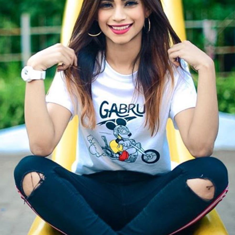 Nagma Mirajkar posing as mouse with mouse ears and wearing white tshirt and blue stylish jeans