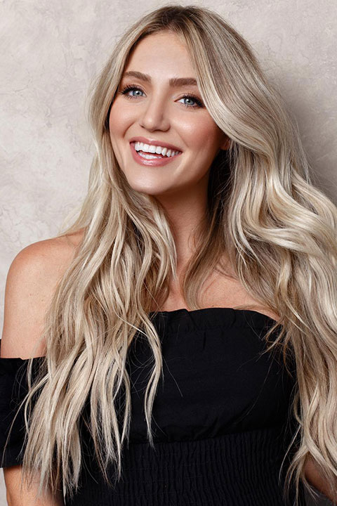 Savannah Soutas with a powerful smile and perfectly placed white hair colour