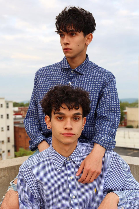 The Dobre Twins wearing check shirts and showing their cute and handsome smiles.