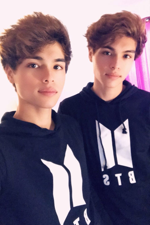 The Stokes twin wearing identical black BTS hoodies