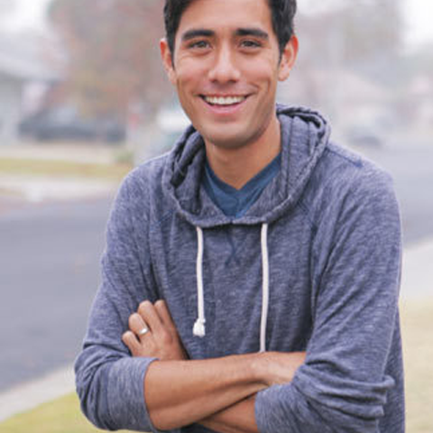 Zach king smiling in blue hoodie