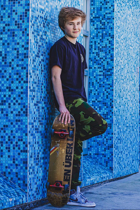 Casey Simpson with his skateboard