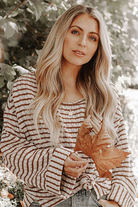 Chantelle Paige Soutas enjoying autumn season with a dry leaf in her hand