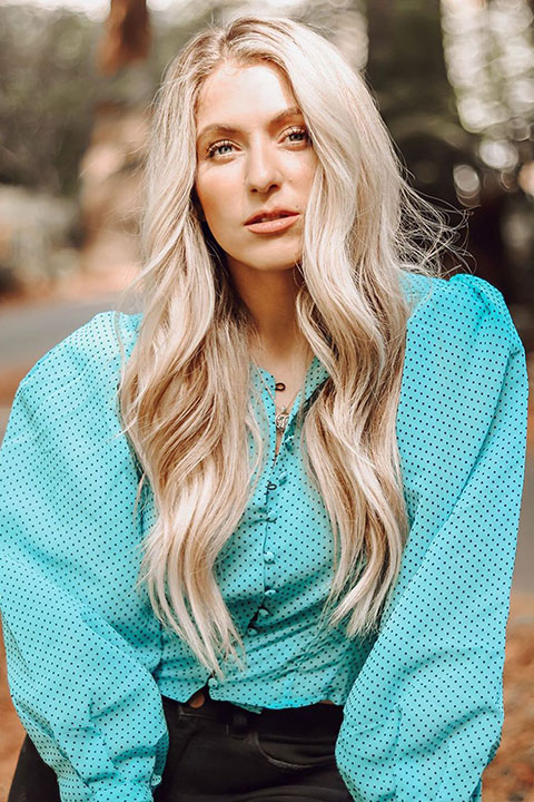 Chantelle Paige Soutas letting sun shining perfectly on her face and shining on her white hair.