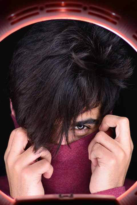 Umer Fayyaz Butt with stylish hair style and purple mask
