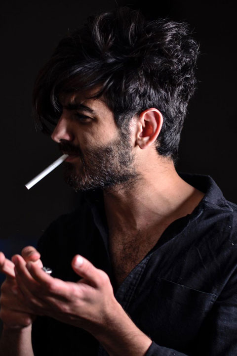 Umer Fayyaz Butt in black shirt and cigarette in mouth