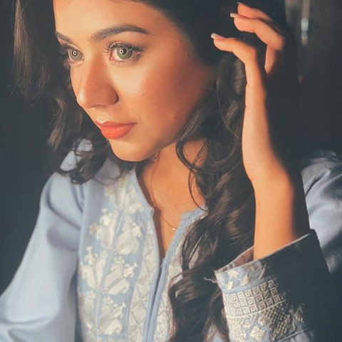 Areeka Haq posing with her beautiful green eyes and blue shirt