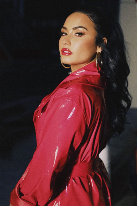 Demi Lovato rocking the colour red with red lipstick and shinny red dress