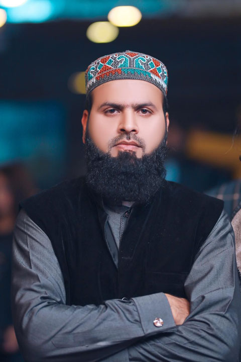 Malik Usman wearing grey kurta and black waistcoat