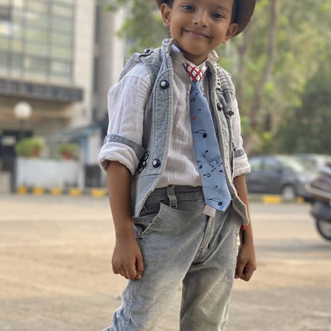 Sadim Khan wearing cute hat and tie and posing for the camera