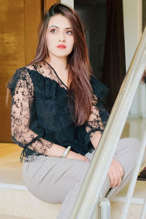 Sehar Hayyat is looking amazing in black dress and net sleeves. She is wearing red lipstick and her brown hair are falling over her shoulder