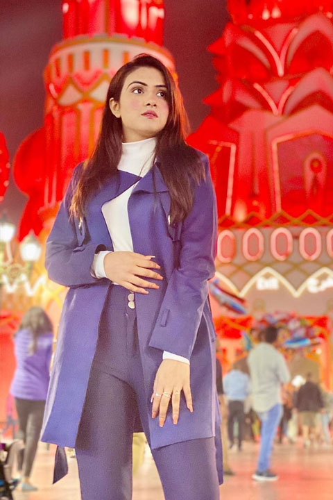 Sehar Hayyat enjoying in skin tight blue jeans and wearing blue over coat.