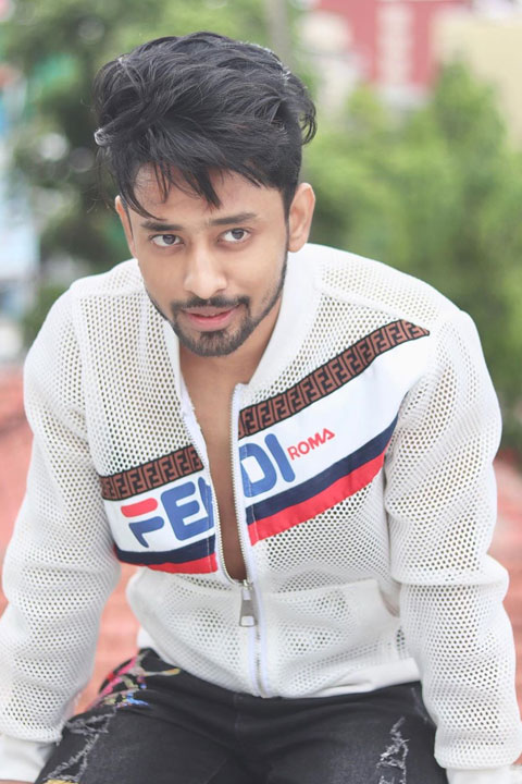 Sohail Shaikh wearing white see through net shirt and showing his masculine chest.