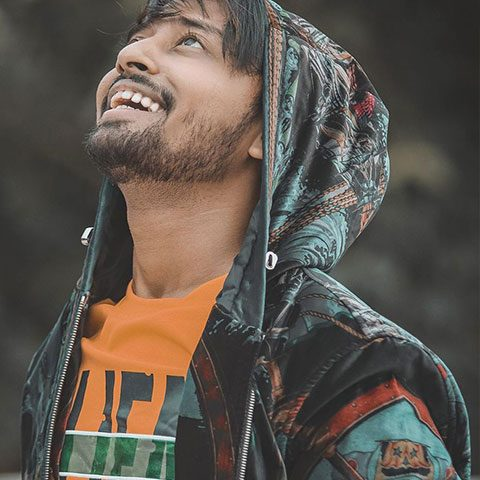 Sohail Shaikh enjoying and being happy while looking up. We can see his perfect jawline