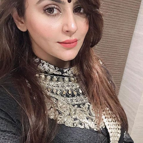 Dolly Sidhu looking exotic and attractive in black dress and light red lipstick