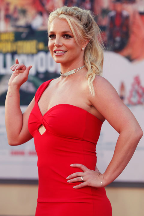 Britney Spears is looking gorgeous in red dress and white neckless.