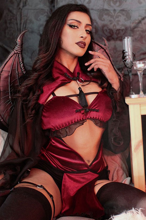 Devi Chai is looking hot in red dress and open hair.