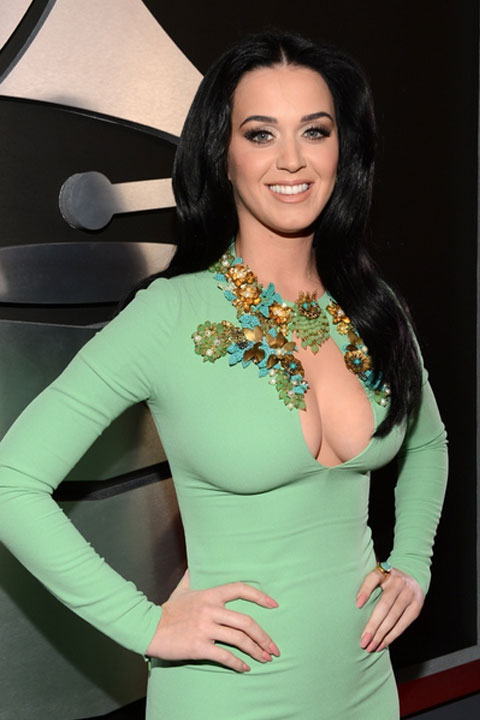 Katy Perry is wearing pretty green dress and giving a beautiful smile