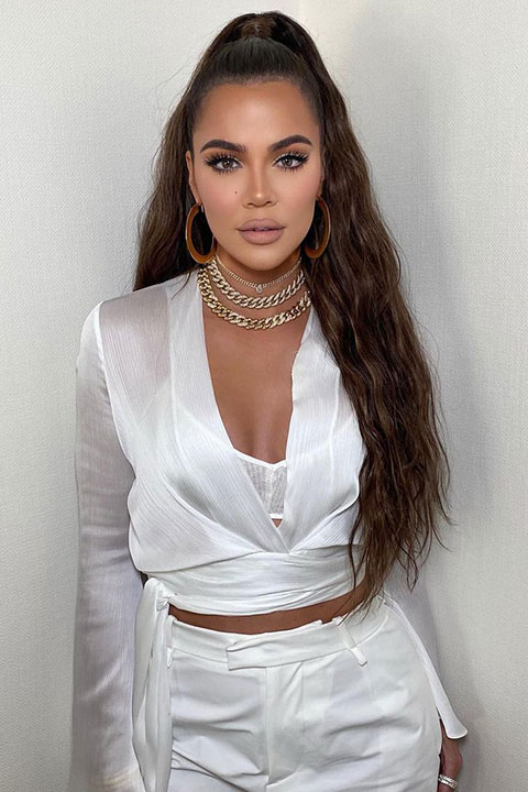 Khloe Kardashian is looking hot in white dress and ponytail.