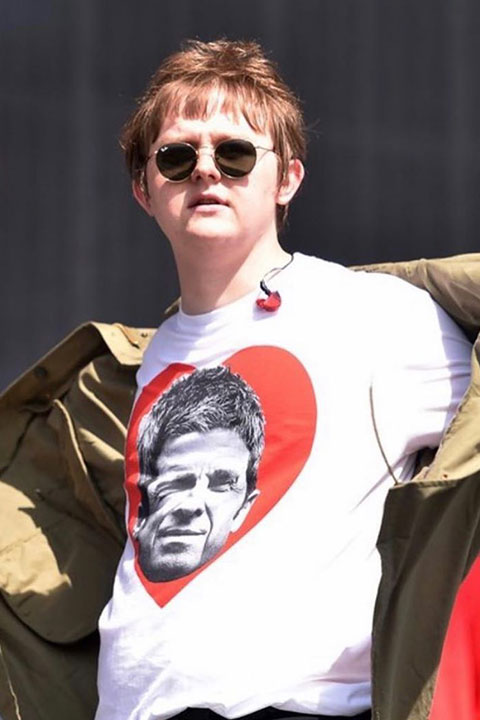 Lewis Capaldi is wearing black glasses and white shirt