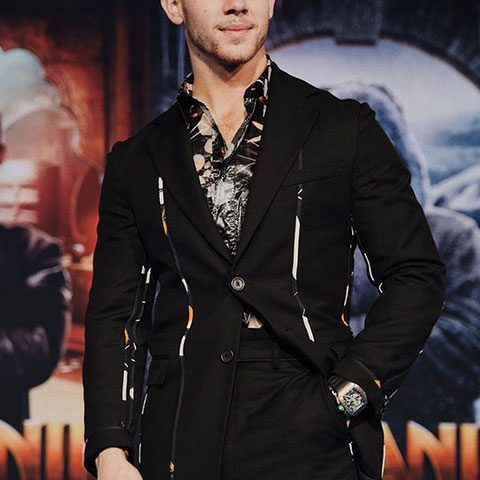 Nick Jonas is looking gorgeous in full black dress and watch