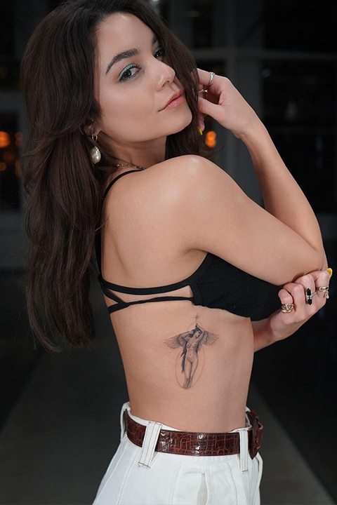 Vanessa Hudgens have tattoo on her belly