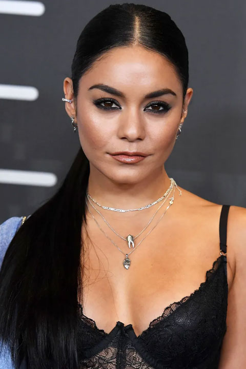 Vanessa Hudgens is looking beautiful in black dress and the silver chains in her neck are looking stunning.