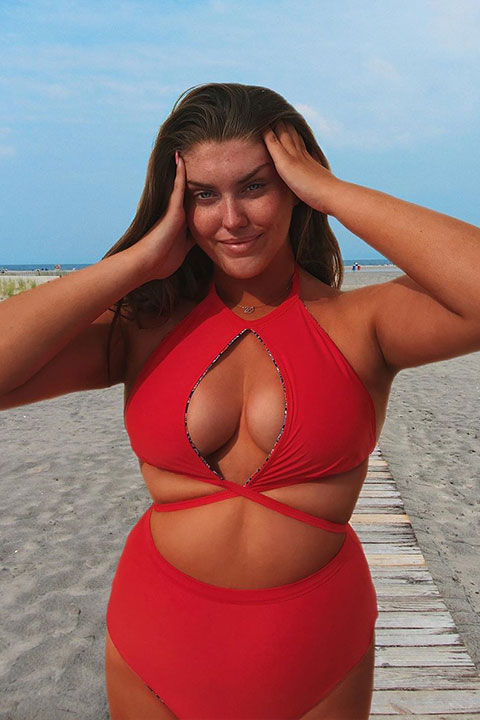 Cartier Antoinette in beautiful red dress at beach
