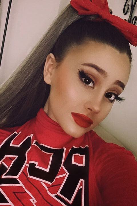 Paige Niemann Doppelganger of Ariana Grande in red theme getup and lipstick