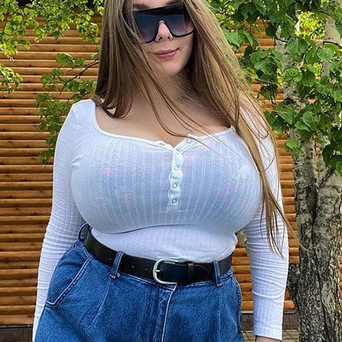 Luccy Sofia in white shirt and blue jeans and she is wearing glasses.