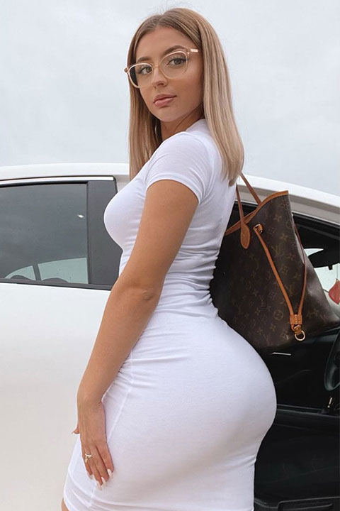 Lilith Cavaliere looking curvy in white dress