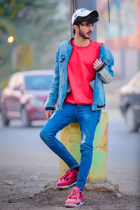Hussain tareen in red shirt and blue jeans