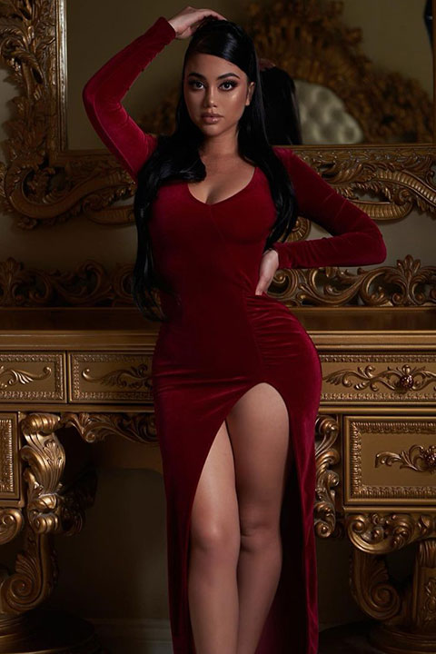 Jailyne Ojeda is posing for a picture in red dress and looking stunning.