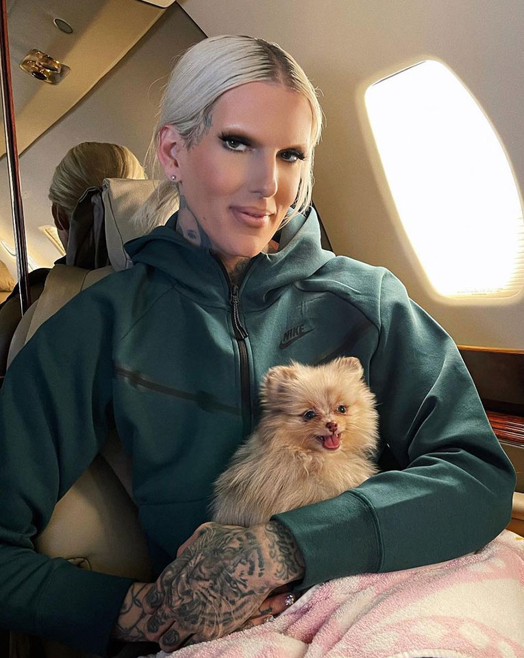 JeffreeStar with his pet dog in his private jet plane
