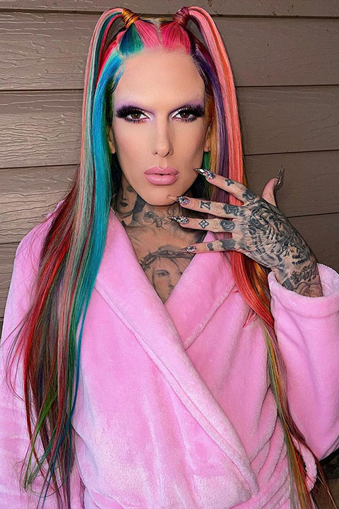 Jeffree star in rainbow color hairs and wearing shower towel