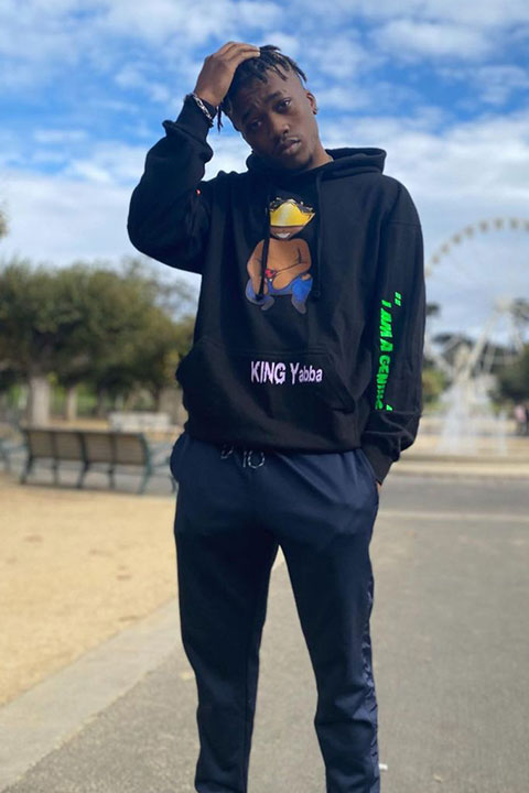 KING Yabba wearing his own merch brand clothes