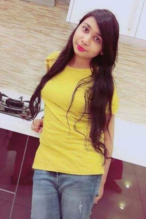 Neha Hussain in yellow shirt and blue jeans