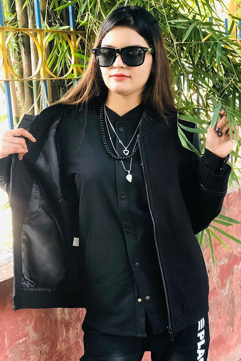 Silent girl in black dress and shades
