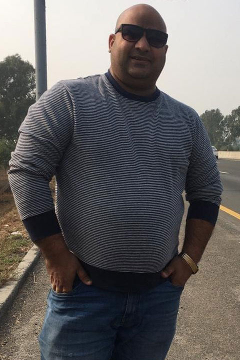 Bhola Record in grey shirt and Blue jeans