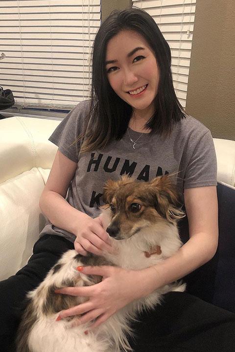 Rumay Wang (Hafu) cuddling her dog