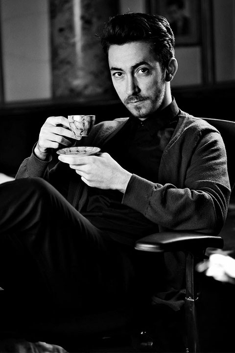 Michael Nicolae posing while taking cup of tea